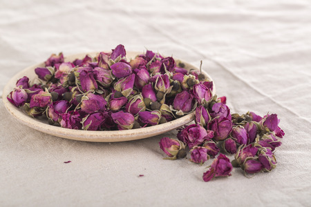 flavoursome: Dried Rosa damascena mainly used for production of rose oil and pink water and therapies Stock Photo