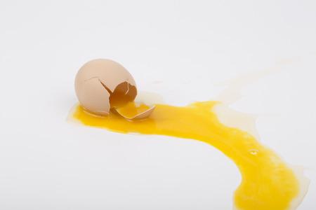 Broken egg isolated on white background.