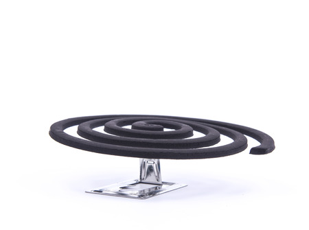 repellant: Image of a mosquito coil.