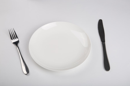 Plate knife and fork on the white