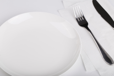 inox: Plate knife and fork on the white