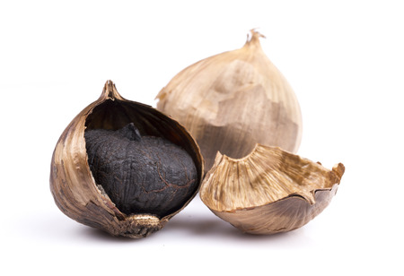 Black garlic isolated on the white background