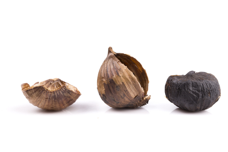 Black garlic isolated on the white background Stock Photo