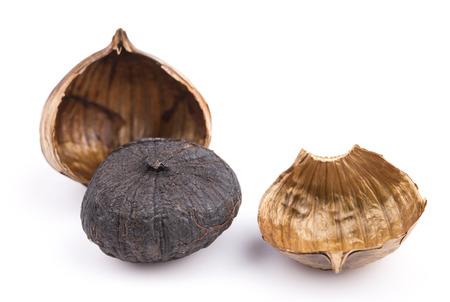 clove plant: Black garlic isolated on the white background Stock Photo