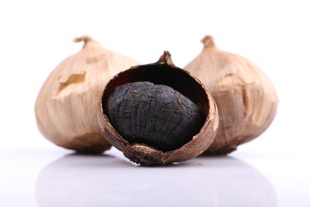 Black garlic isolated on the white background Stock Photo