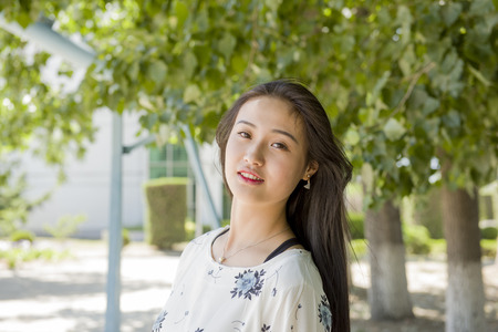 collegian: Beautiful Asian college student portrait Stock Photo