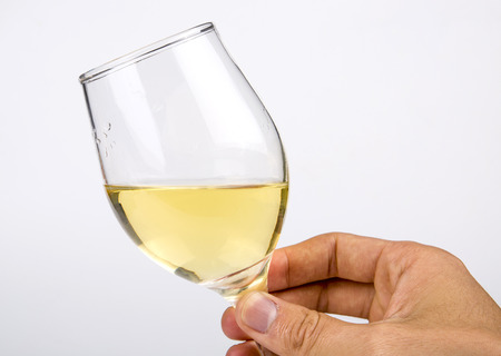 Holding hands a glass of white wine closeup