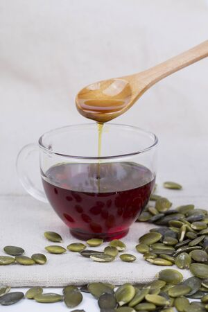 Pumpkin seed oil and seeds on the table Stock Photo