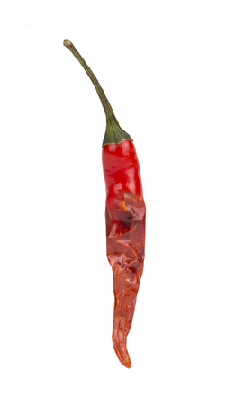 chiles secos: Half Fresh and half dried red hot chili pepper isolated on the background.