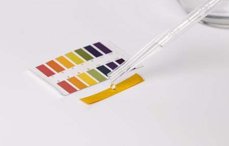 Litmus ph test paper on white.