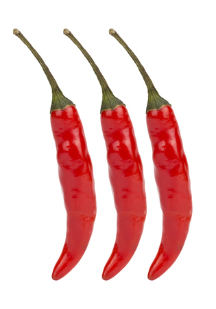 chiles secos: Red hot chili peppers isolated on the background. Foto de archivo