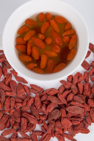 chinese wolfberry: Wolfberry Goji tea and Chinese wolfberry on the white background