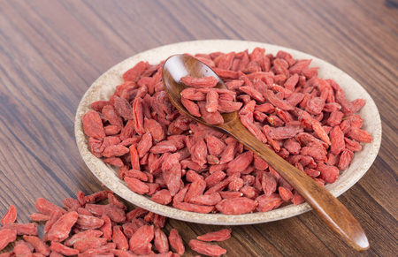 chinese wolfberry: Dried Goji Berries also known as Wolfberry on a plate