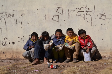 Tibetan students were reading book in shcool in Qinghai province, China