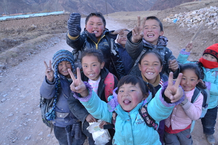 Tibetan students come home from school in sunset in Qinghai province, China Editöryel