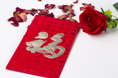 HongBao and Wine Glass. Red envelopes called HongBao, with a Fu word ,which means happiness.HongBao is usually used when Chinese traditional new year the Spring Festival is coming.