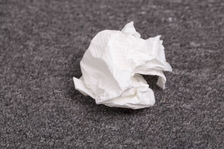 paper wad: Crumpled paper ball on the carpet
