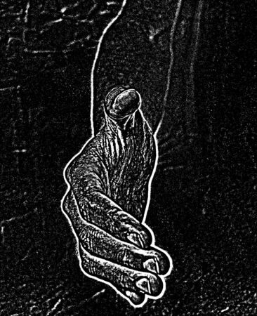 reaches: A hand reaches out in the dark