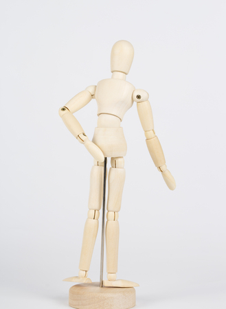 Wooden puppets,  back or thigh pain.