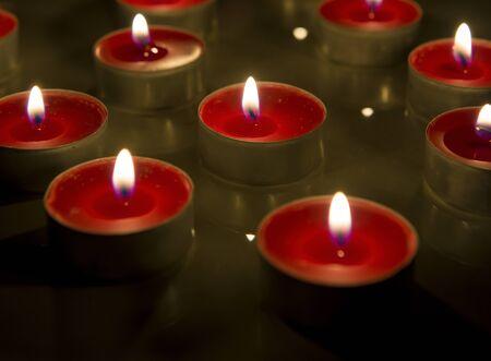 Burning candle isolated on black background. Stock Photo
