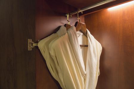 pyjama: Pajamas hanging in cupboard. Stock Photo