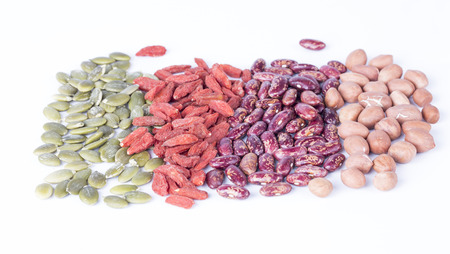 garbanzos: Dry pumpkin seeds, peanuts, beans, wolfberry on white background.