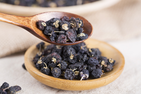 Traditional Chinese black herbs dried wolfberry close up. Black wolfberry, goji.