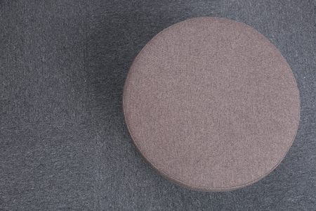 stool: Top view of stool sitting on gray floor. Stock Photo