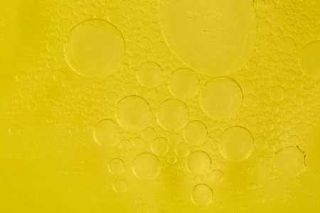 Bubbles of water in olive-oil, macro.