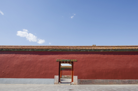 Red wall and door background in the Forbidden city in Beijing, China.