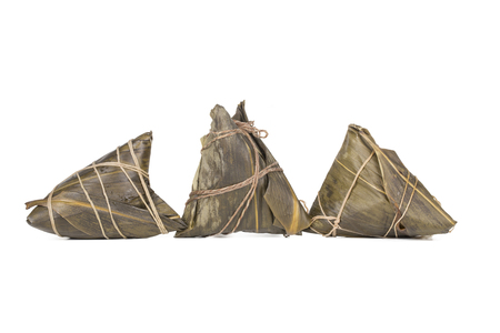 Zongzi or called rice dumplings isolated on the white background. The food is very popular during the Dragon Boat Festival in China.