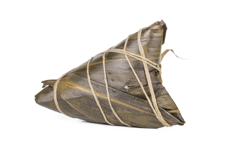 Single Zongzi or called rice dumpling isolated on the white background. The food is very popular during the Dragon Boat Festival in China. Stock Photo