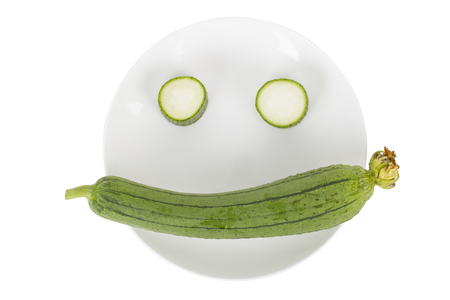 Smiling face from fresh loofah on the white background.