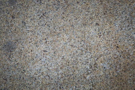 Concrete wall with pebbles for use as background.