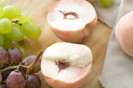 Peaches and grapes on the table. Closeup. Stock Photo