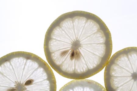 Fresh lemon slices on the white background.