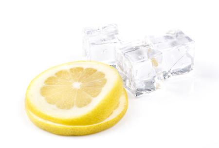 drop water: Ice cubes and lemon slices on white background.