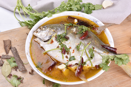 Cooked pompano served in a plate. Stock Photo