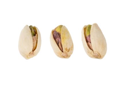 Three Pistachio Nuts .
