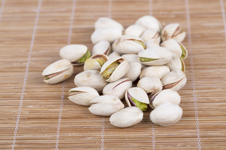 Pistachio nuts closeup.
