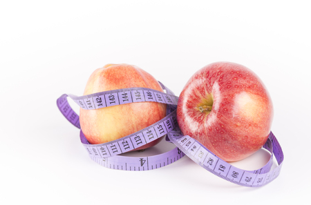 Red apple and measurement tape. Concept for health, diet
