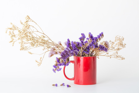 Dried flowers in a red cup