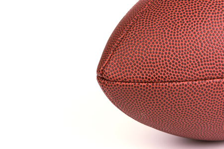 Closeup of American football on white background