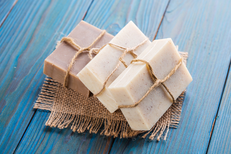 Handmade soap on a blue wooden table