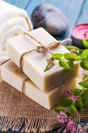 Spa skin care concept, natural handmade soap and flowers 写真素材