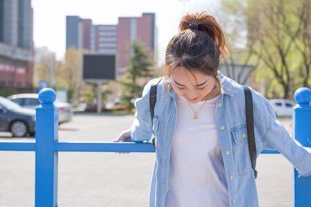 Girl student in university. Portrait of young Asian female university student - Asian Chinese woman. Standard-Bild