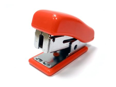 small red stapler on the white isolate background    Stock Photo