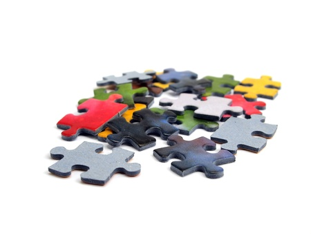 color puzzle pieces on the white background  photo