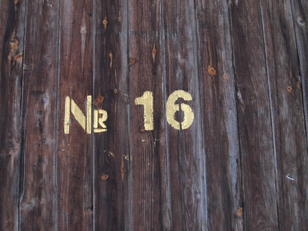 number sixteen painted on a old wood texture background pattern  photo