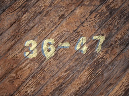 painted numbers on a old wood texture background pattern  photo